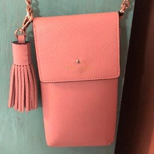 Pale pink cross body Kate Spade purse.